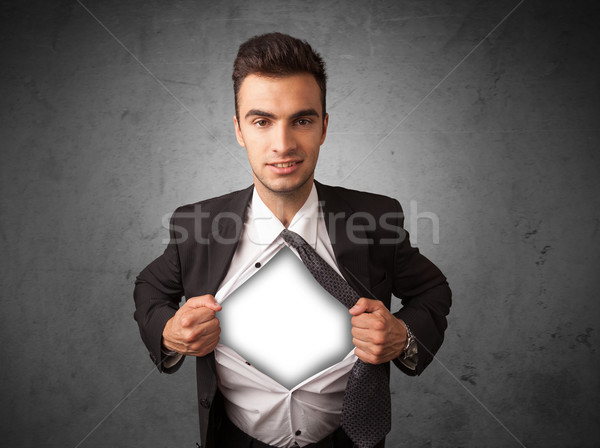 Businessman tearing off his shirt with white copyspace on chest Stock photo © ra2studio
