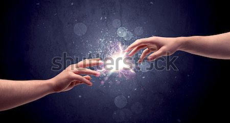 Stock photo: Touching arms lighting spark at fingertip