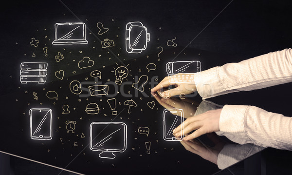 Man pressing table tablet hand touch interface with media icons Stock photo © ra2studio