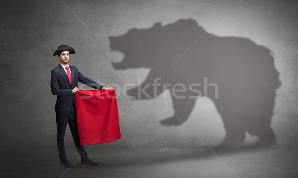 Businessman with bear shadow and toreador concept Stock photo © ra2studio