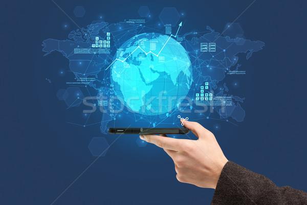 Mão tocante telefone global relatório Foto stock © ra2studio