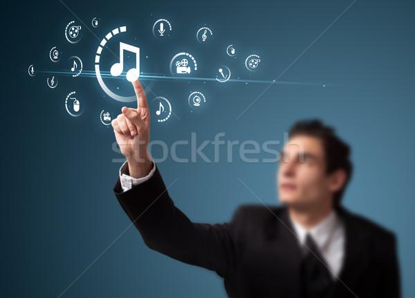 Zakenman virtueel media type knoppen Stockfoto © ra2studio