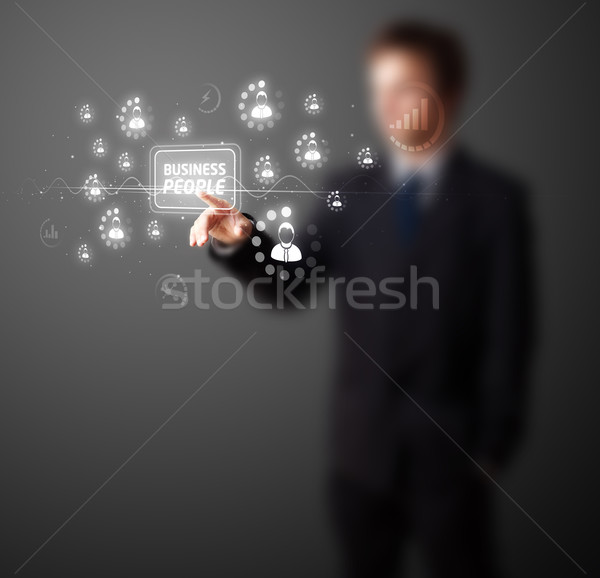 Stock photo: Businessman pressing modern business type of buttons