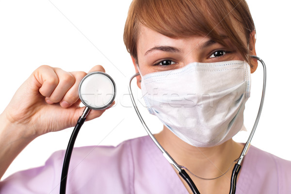 doctor holding stethoscope pointed toward camera Stock photo © ra2studio