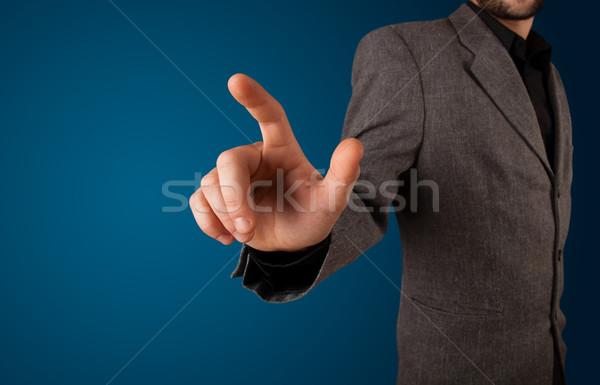 Zakenman denkbeeldig knop jonge business Stockfoto © ra2studio