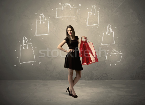 Mall lady with drawn shopping bags on wall Stock photo © ra2studio