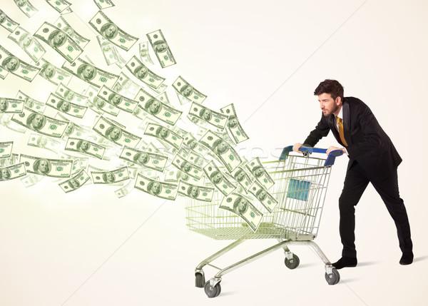 Empresario cesta de la compra empujando fuera compras Foto stock © ra2studio