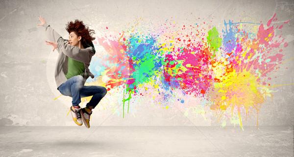 Gelukkig tiener springen kleurrijk inkt splatter Stockfoto © ra2studio