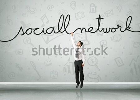 Suspendu affaires réseau social corde affaires main Photo stock © ra2studio