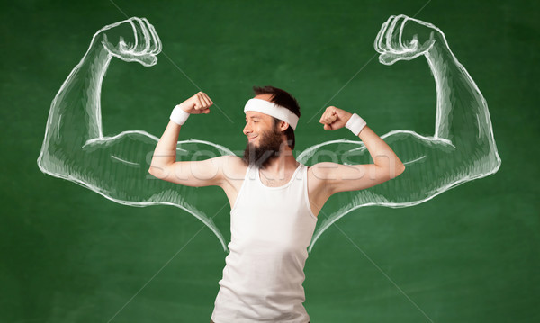 Skinny young man working out Stock photo © ra2studio