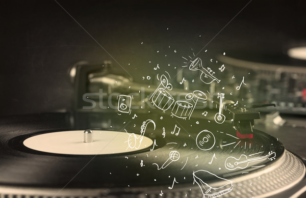 Turntable playing classical music with icon drawn instruments  Stock photo © ra2studio