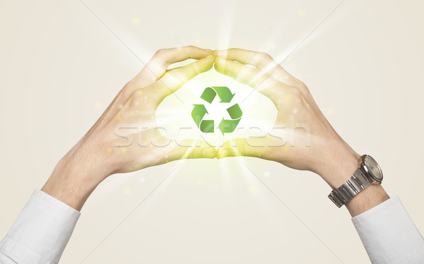 Hands creating a form with recycling sign Stock photo © ra2studio