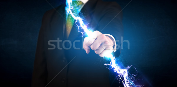 Homme d'affaires électricité lumière mains Photo stock © ra2studio