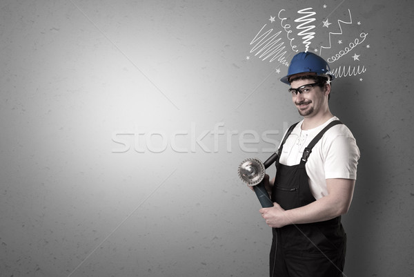 Factotum with tool.  Stock photo © ra2studio