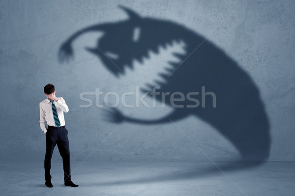 Business man afraid of his own shadow monster concept Stock photo © ra2studio