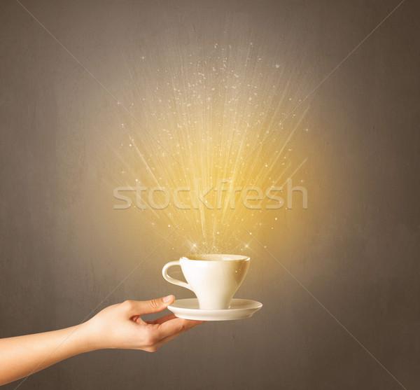 Female hand holding coffee cup Stock photo © ra2studio