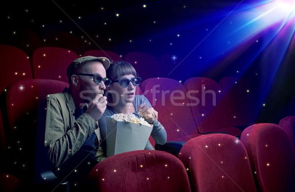 Lovely couple watching 3D movie Stock photo © ra2studio