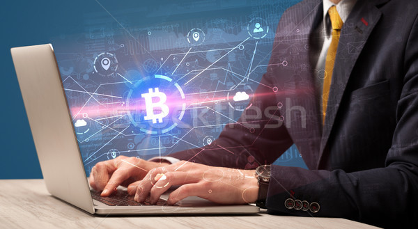 Hand checking  global bitcoin exchange rate concept Stock photo © ra2studio