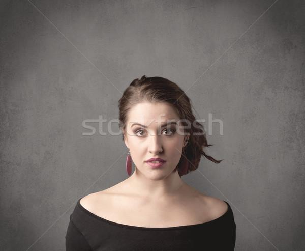 Dziewczyna funny wyraz twarzy dość młodych Zdjęcia stock © ra2studio