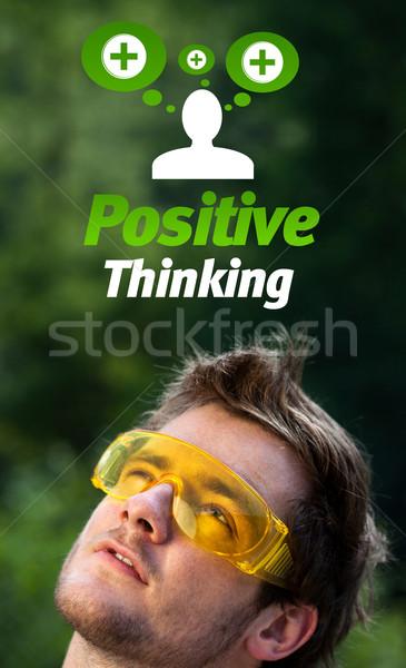 Genç kafa bakıyor pozitif negatif işaretleri Stok fotoğraf © ra2studio