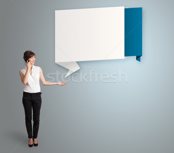 pretty young woman making phone call and presenting modern origami copy space Stock photo © ra2studio