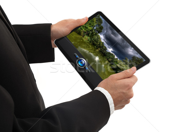 male hand holding a touchpad pc showing a movie Stock photo © ra2studio