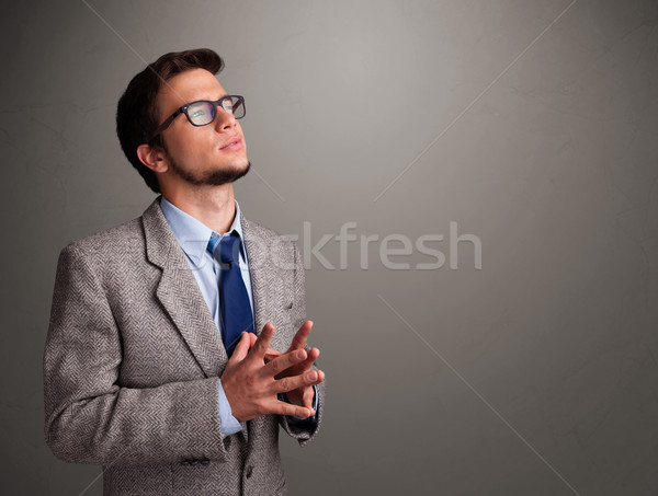 Stock photo: Young man thinking with empty copy space