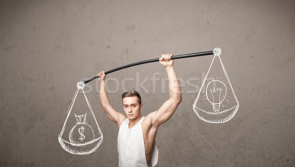 muscular man trying to get balanced  Stock photo © ra2studio