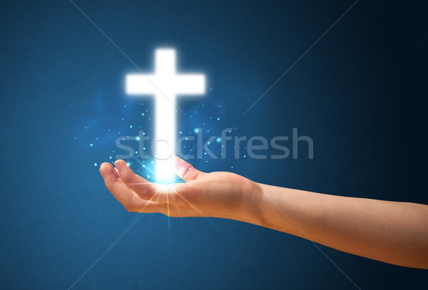 Stock photo: Glowing cross in the hand of a woman