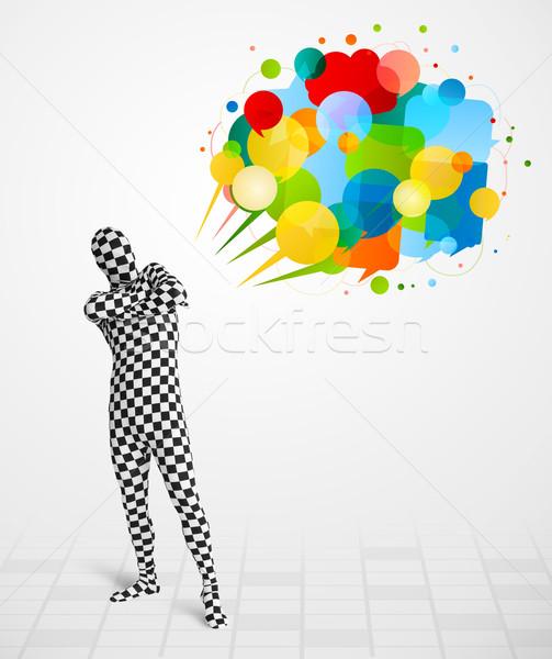 Strano ragazzo guardando colorato divertente Foto d'archivio © ra2studio