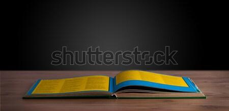 Open book on wooden deck Stock photo © ra2studio