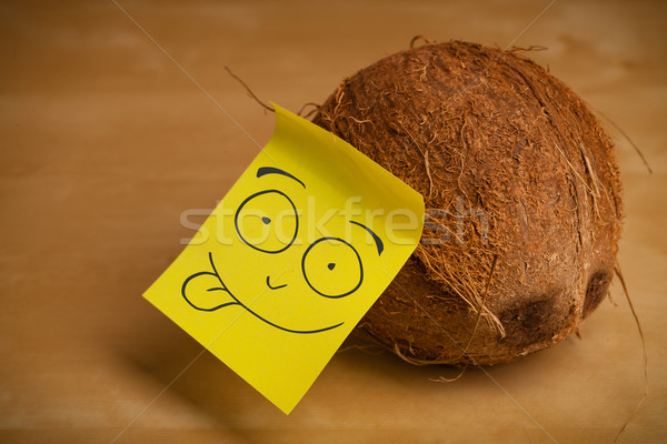 Post-it note with smiley face sticked on a coconut Stock photo © ra2studio