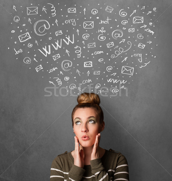 Young woman thinking with social network icons above her head Stock photo © ra2studio