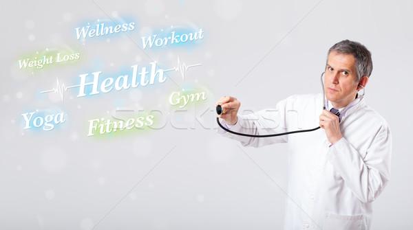 Clínico médico senalando salud fitness colección Foto stock © ra2studio