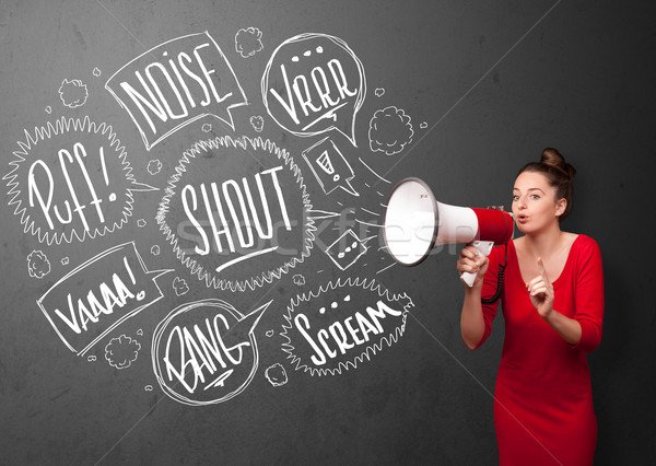 Stock photo: Girl yelling into megaphone and hand drawn speech bubbles come o