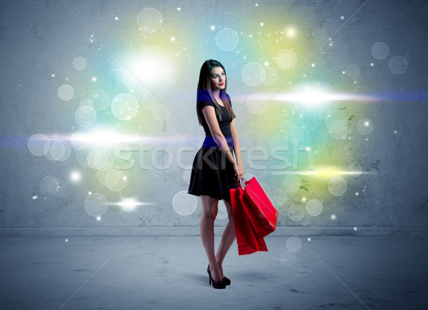 Mall lady with shopping bags and glitter light Stock photo © ra2studio