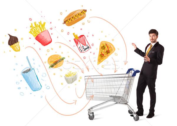 Férfi bevásárlókocsi mérgező egészségtelen étel üzletember toló Stock fotó © ra2studio