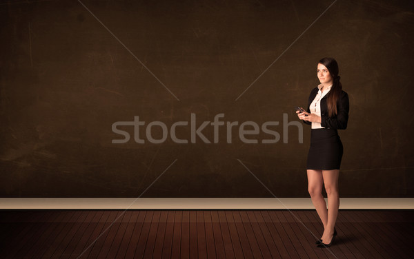 Businesswoman holding high tech tablet on background with copysp Stock photo © ra2studio