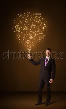Businessman with a social media balloon Stock photo © ra2studio