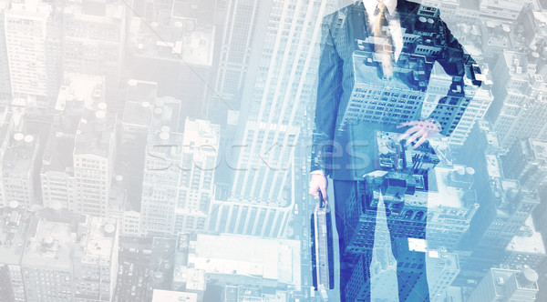 Business person standing with cityscape in the background Stock photo © ra2studio