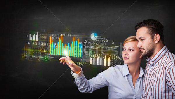 ストックフォト: 小さな · ビジネス · カップル · 触れる · カラフル · チャート