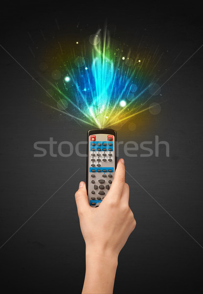 Stock photo: Hand with remote control and explosive signal