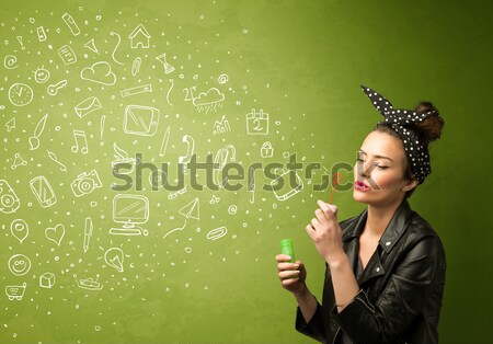 Cute girl blowing hand drawn media icons and symbols Stock photo © ra2studio