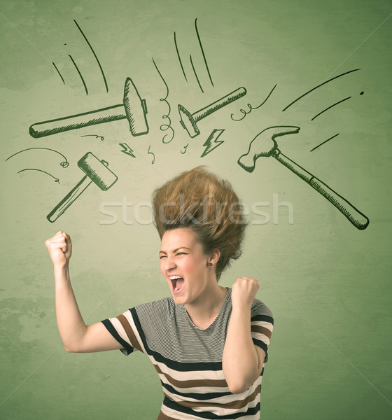 Tired woman with hair style and headache hammer symbols  Stock photo © ra2studio