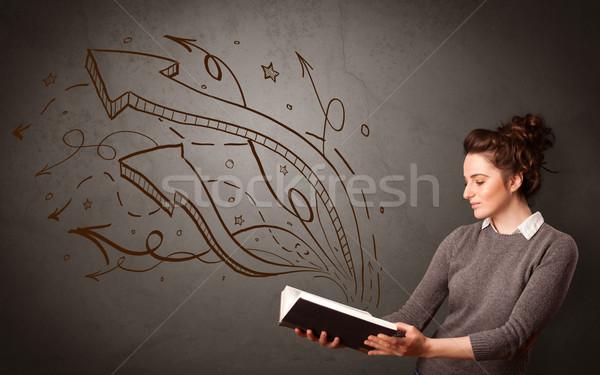 Fiatal hölgy tart könyv nyilak lezser Stock fotó © ra2studio