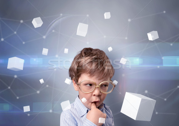 Cute kid with luminous cubes around Stock photo © ra2studio