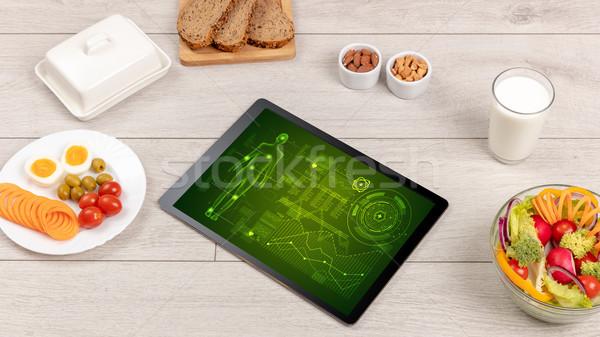 Egészséges étel tabletta test diagnózis képernyő étel Stock fotó © ra2studio