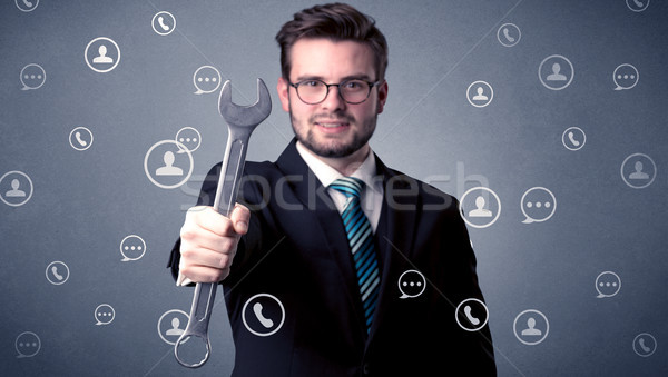 Handsome man standing with tool on his hand Stock photo © ra2studio