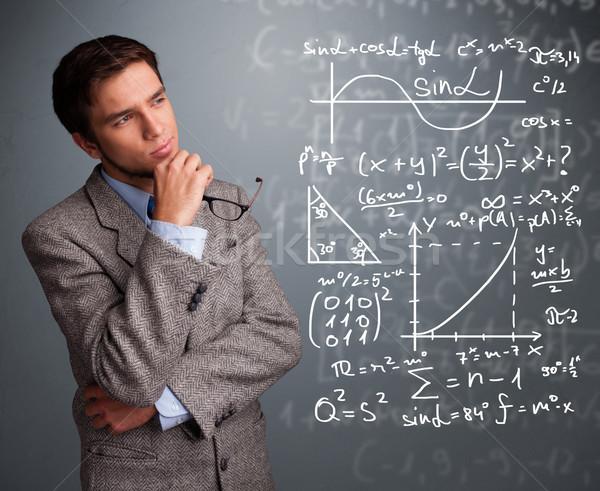 ハンサム 男子生徒 思考 複雑な 数学の 標識 ストックフォト © ra2studio