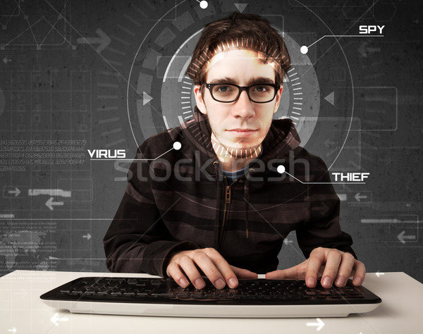 Young hacker in futuristic enviroment hacking personal informati Stock photo © ra2studio